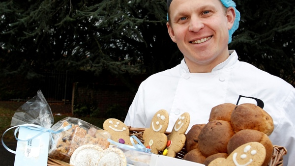 Artisan Bakery Manager, Dylan Needham with basket of seasonal goods