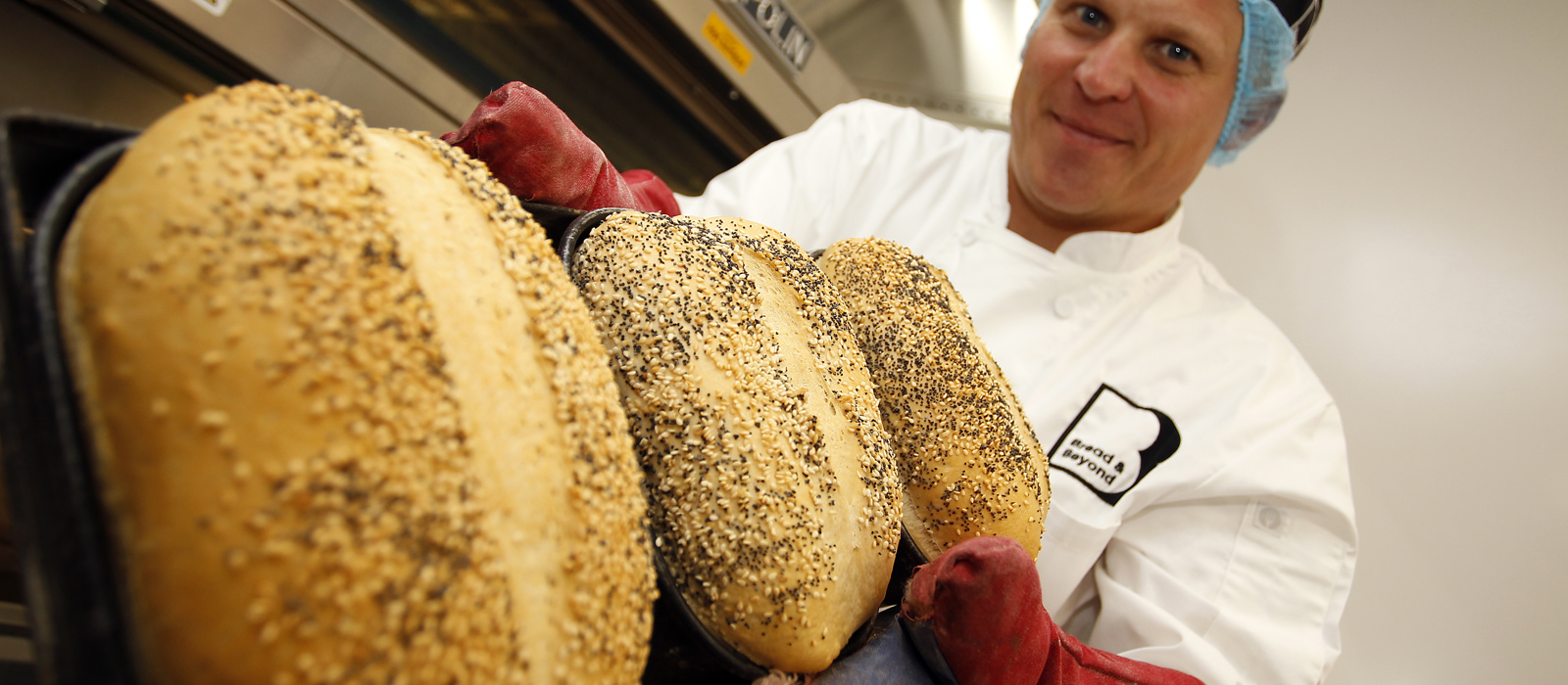Bakery Manager, Dylan with freshly baked bread